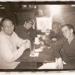 Barry Katz with clients Jeffrey Ross, Jordan Rubin, and Dave Chappelle at the Olive Tree Cafe above the Comedy Cellar in Greenwich Village in New York City.